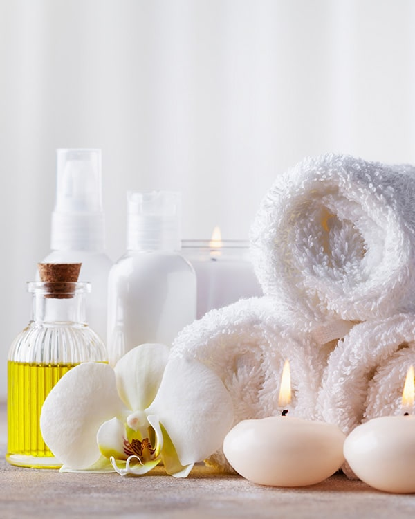 Various towels, candles and essential oils in a spa