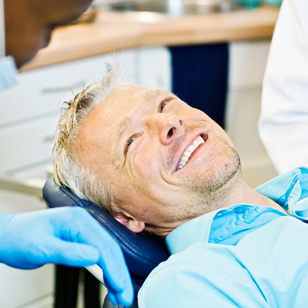 A man relaxing in a dental chair